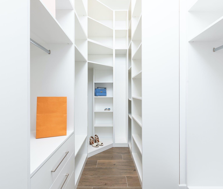 design of modern white wardrobe with shelves